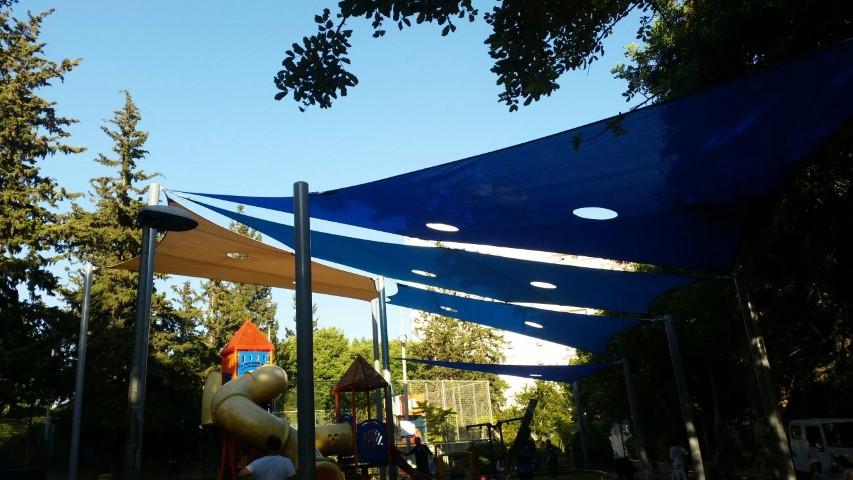 גן משחקים בנוה שאנן אחרי עבודות הצללה (צילום: דוברות עיריית חיפה)