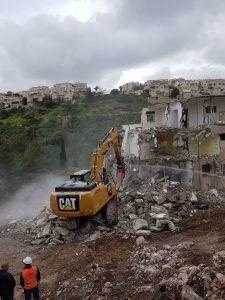 """הריסת הבניין הראשון בפרויקט (צילום: יח""""צ)"""