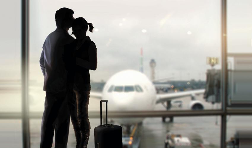 זוג בשדה התעופה (צילום: א.ס.א.פ קריאייטיב/INGIMAGE)