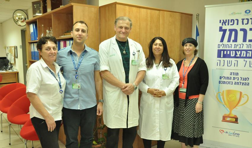 צוות המציגים של המרכז הרפואי כרמל בכנס של המועצה הלאומית ללוגיסטיקה במערכת הבריאות (צילום: אלי דדון)