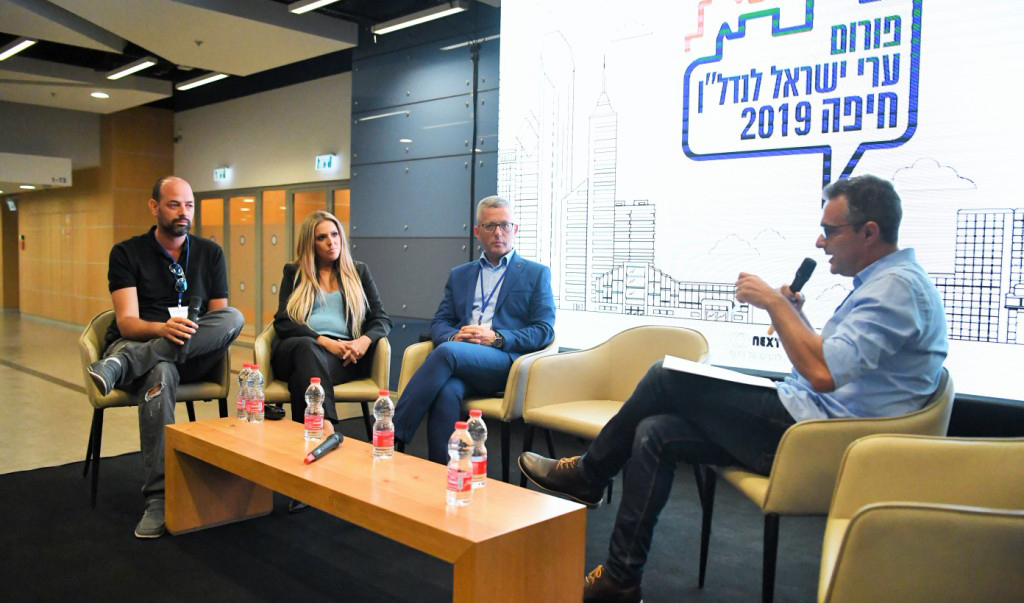 פאנל בנושא הזדמנויות השקעה בשכונות חיפה (צילום: ראובן כהן)