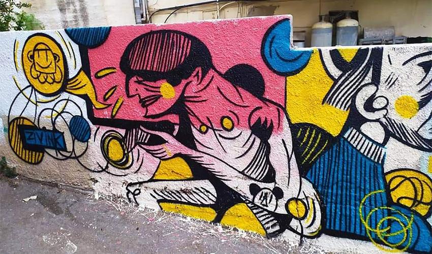 עבודת הגרפיטי של זיו שמח על החומה ברחוב מסדה (צילום: זיו שמח)