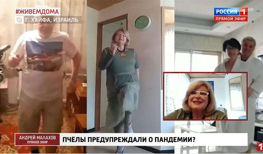 מרינה קוגן בתוכנית הטלוויזיה ברוסיה, כשלצדה רוקדים אביה בסיביר וחבריה בסרביה