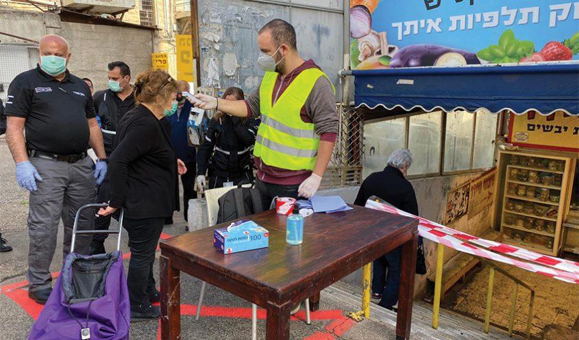 הכניסה לבניין שוק תלפיות בסגר הקודם (צילום: ראובן כהן, דוברות עיריית חיפה)