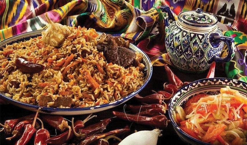 """ארוחה אוזבקית מסורתית. """"צריך לדעת איך להכין אוכל לכל כך הרבה אנשים"""" (צילום מתוך דף הפייסבוק Uzbekfood_hayfa)"""