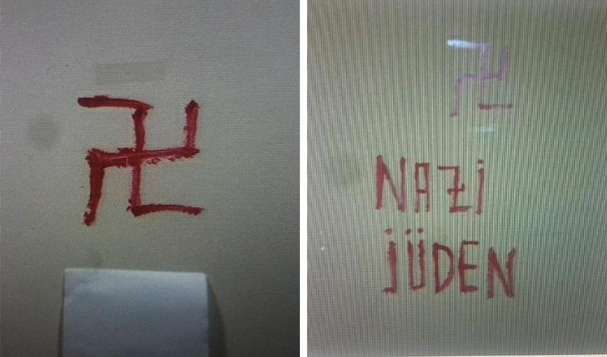 הכתובות שרוססו על קיר הבניין (צילום: דוברות משטרת ישראל)