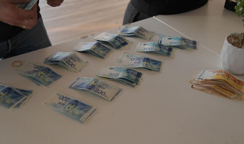 הכסף שנתפס בפעילות המשטרתית (צילום: דוברות המשטרה)