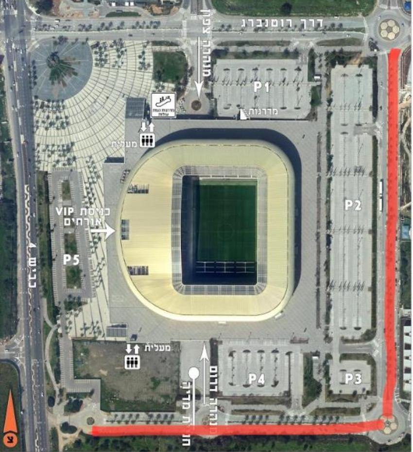 המספרים הלבנים מעשרות מקומות חנייה לאורך הכביש העוטף את האצטדיון (מסומן באדום) צילום: חץ הצפון